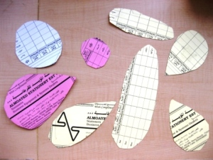 Thin cardboard templates of insect wings, bodies and heads